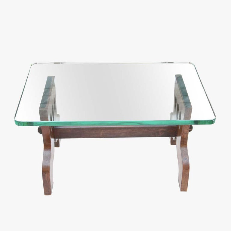 A very organic, rare, iconic and beautiful coffee table. 1940s Italian design by Gio Ponti and Pietro Chiesa for Fontana Arte. Original thick crystal top on a solid oak wood base a very sculptural piece to enhance any type of interior. This table