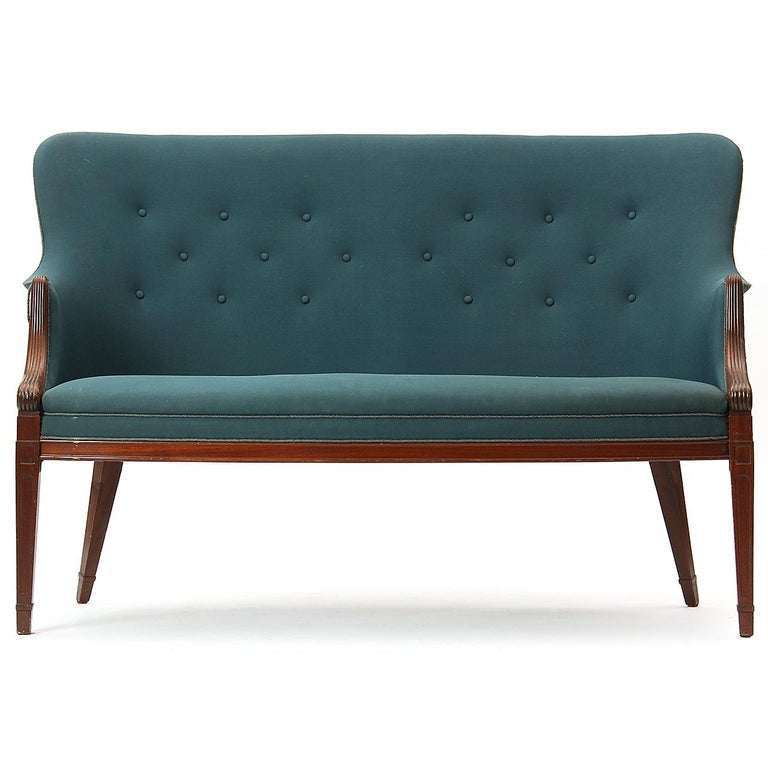 An elegant settee and pair of side chairs with mahogany frames with splayed rear legs and fitted, button-tufted upholstery. Upholstery required. Settee 56