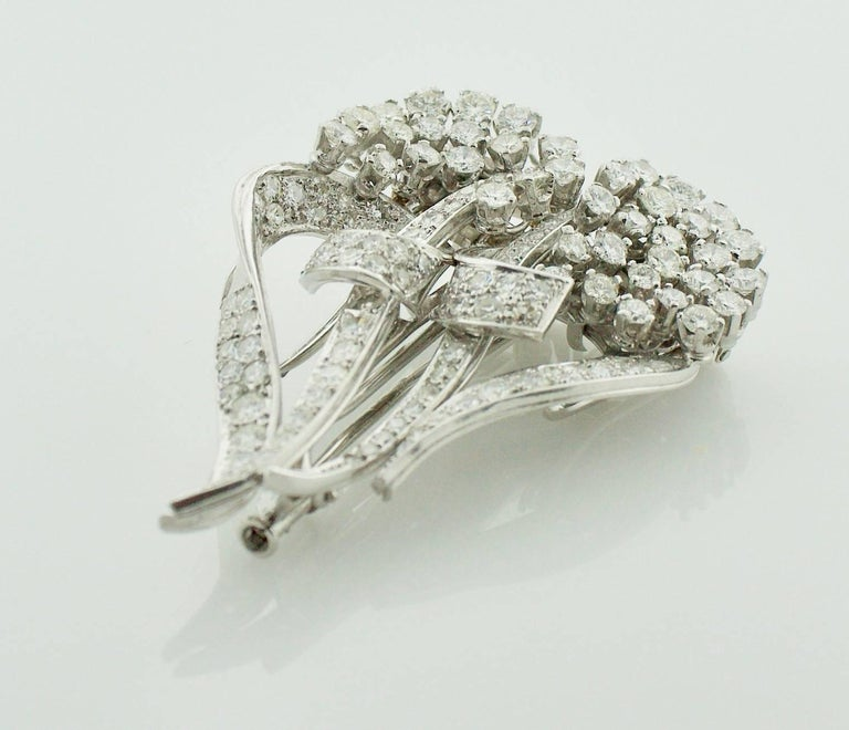 1940's Diamond Brooch Clips and Necklace On Hundred and Six Round Diamonds weighing 6.30 carats approximately Diamonds are Fine Quality  GH VVS-VS Can be Worn Many Different Ways.  How Many?  We've Lost Count   Also can be Attached to a Chain and be