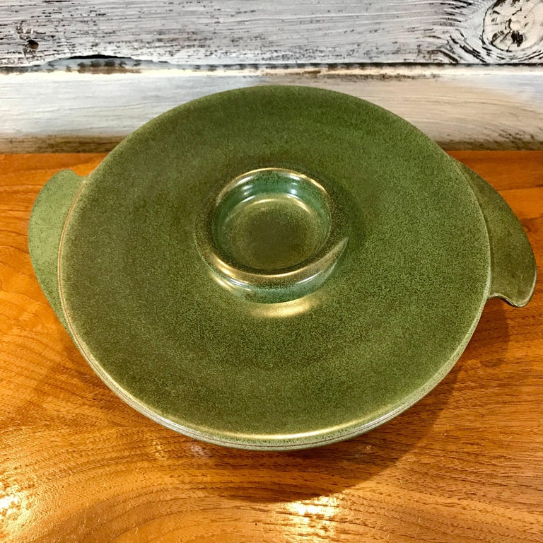 1940s winged covered serving bowl/casserole by Edith Heath for Heath Ceramics of Sausalito, California. An early Heath design, with two wings on the side of the bowl and early Heath markings on the underside. Metallic green glaze, in excellent