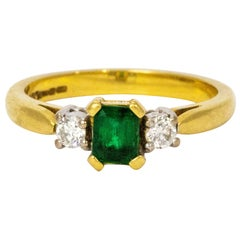 1940s Emerald Diamond Platinum 18 Carat Gold Three-Stone Ring