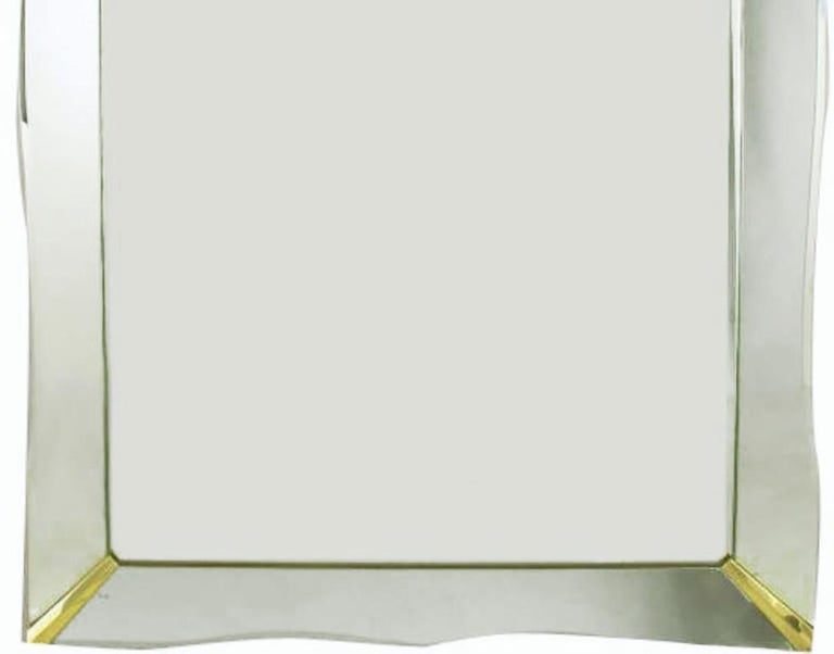 """Marvellous mirror with a scalloped edge frame set on wood backing. Bevelled frame sheathed in mirror, and held in place with brass finished brackets. Can be mounted vertically or horizontally. Measures: 60""""."""