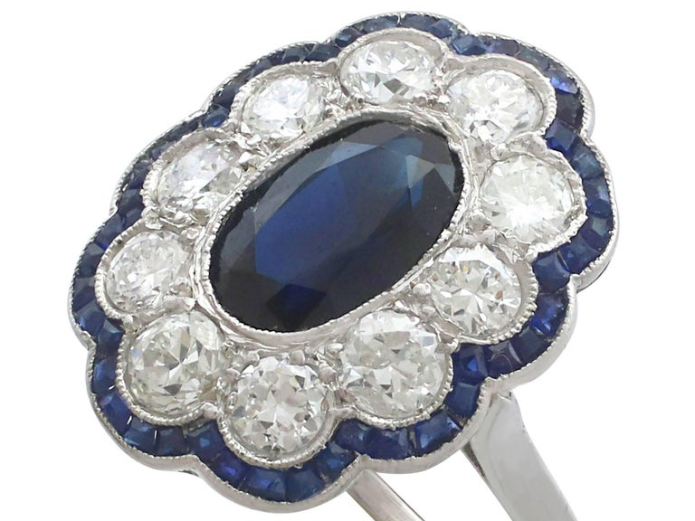 Round Cut 1940s French 1.66 Carat Sapphire and 1.60 Carat Diamond Platinum Cluster Ring For Sale