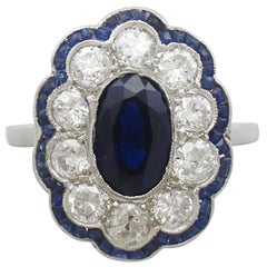 1940s French 1.66 Carat Sapphire and 1.60 Carat Diamond Platinum Cluster Ring