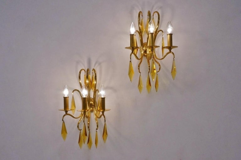 1940s French bronze wall lights attributed to André Arbus. Each wall light is finished with 12 elegant amber faceted crystals which add to this sense of movement and glamour. The swirling metal work has a unique almost 'whiplash curves'
