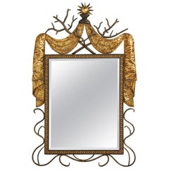 1940s French Gilbert Poillerat Style Parcel-Gilt and Black Iron Wall Mirror