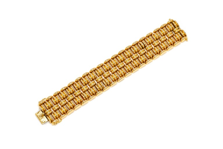 French bracelet finely crafted in 18k yellow gold weighing 68.2 dwt. Circa 1940's.
