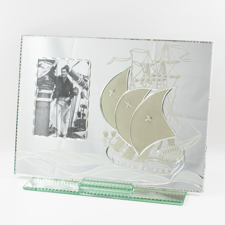 Stunning 1940s large silver mirrored glass picture photo frame. Featuring a separate mirrored glass base with beveling all around supporting an extra-large mirrored glass sheet with reverse etched antique galleon boat decorated with frosted sails