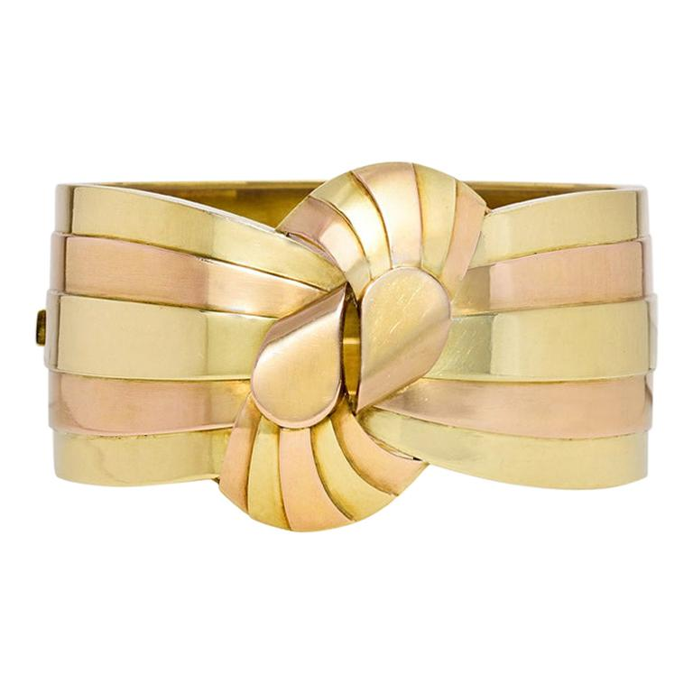 1940s French Two-Color Gold Stylized Bowknot Cuff Bracelet For Sale