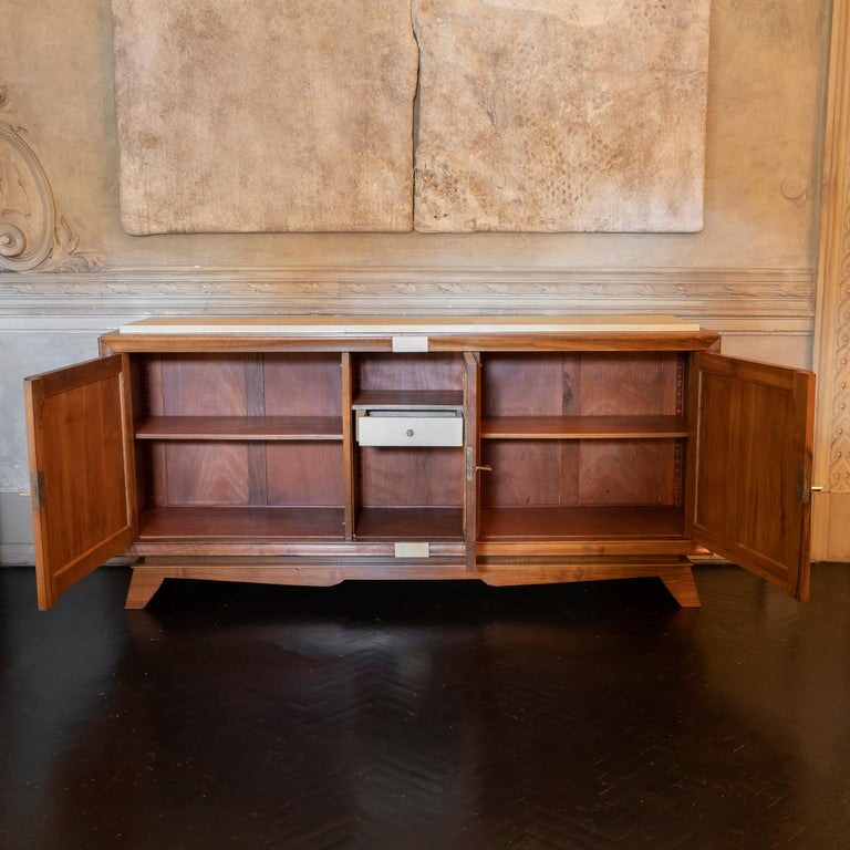 1940s French walnut and parchment sideboard, perfect condition and vintage patina, adjustable shelves and one parchment covered drawer, brass details.