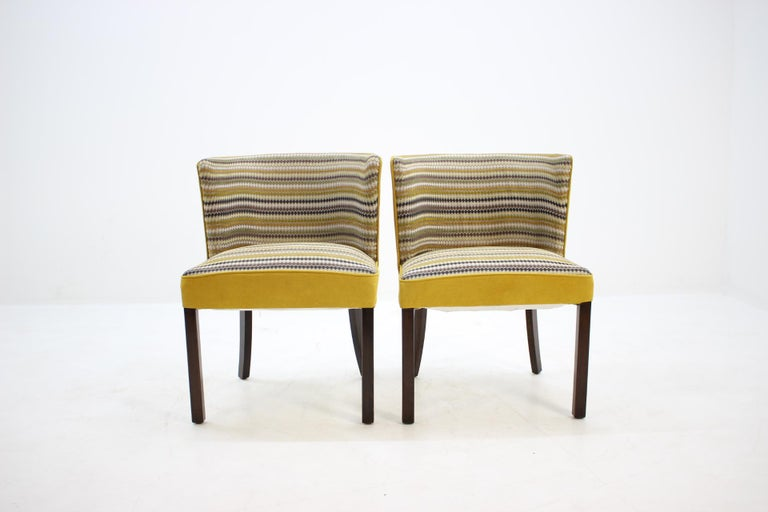 Made in Denmark. Original production of model 1514. Newly upholstered. The wooden legs have been re-polished.