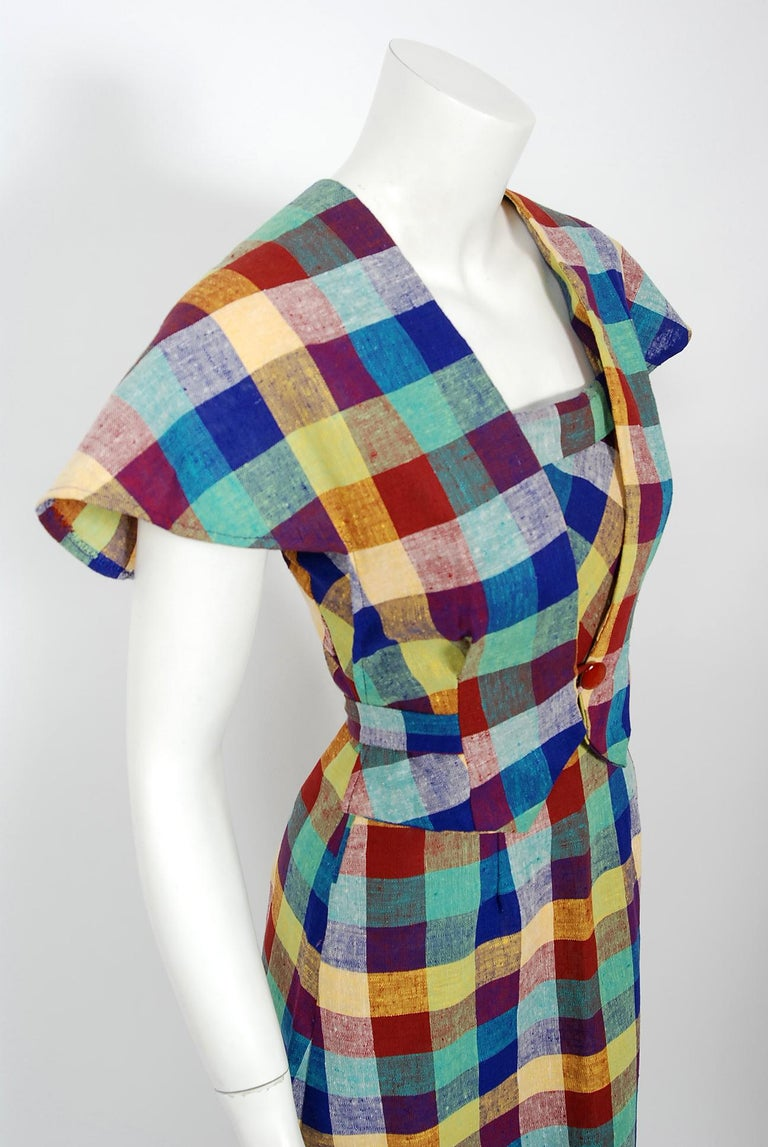 With its vibrant linen-cotton plaid and flawless styling, this Gay Gibson designer dress ensemble has the casual elegance the 1940's were known for. The tri-strap bodice with side buttons is very flattering and effortless to wear. The hourglass
