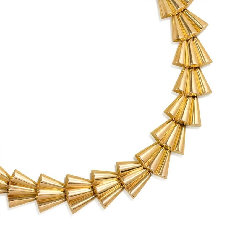 A Retro gold necklace comprised of scalloped fan-shaped links, in 18k.  France