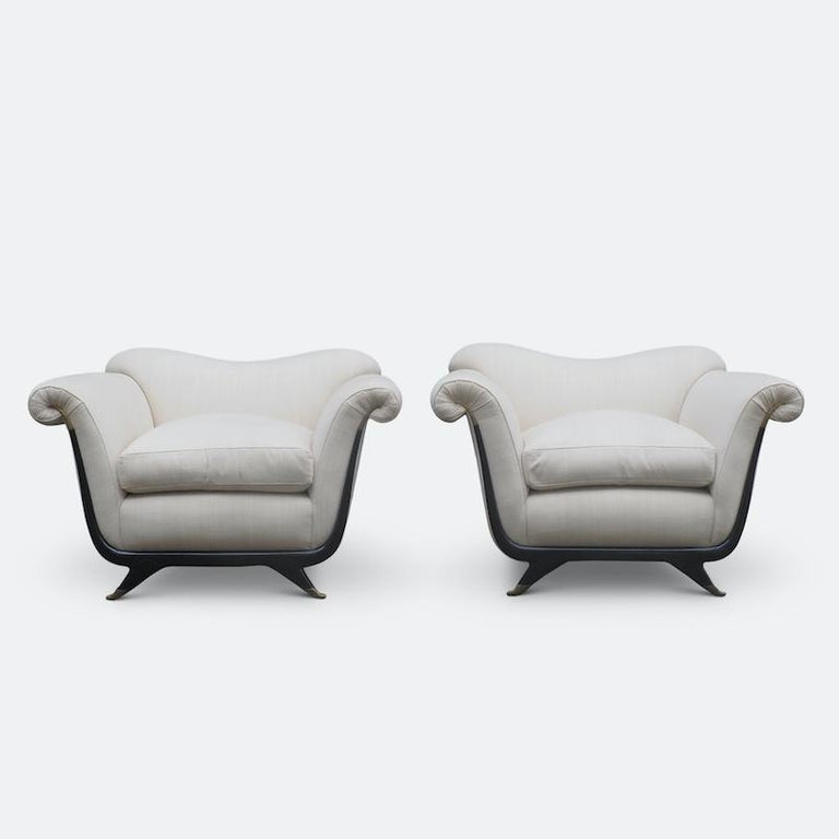 A beautiful pair of armchairs attributed to Guglielmo Ulrich, the master of Italian classicism. These chairs are an exceptional example of Ulrich's architectural skill where line becomes form and back again. The chairs have a wonderful downward