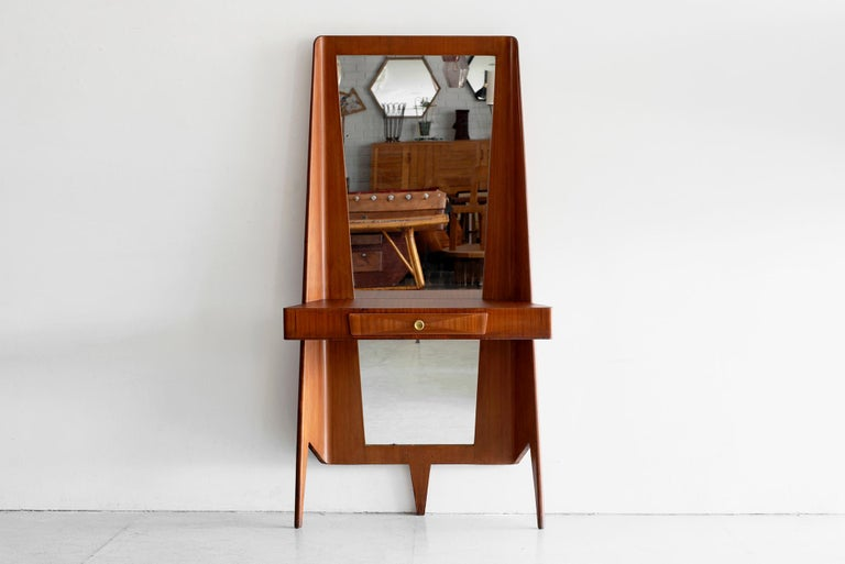 1940s Italian floor mirror for an entry way Unique curved shape with three legs and angular mirror Pencil drawer with brass hardware and shelf (for keys!)