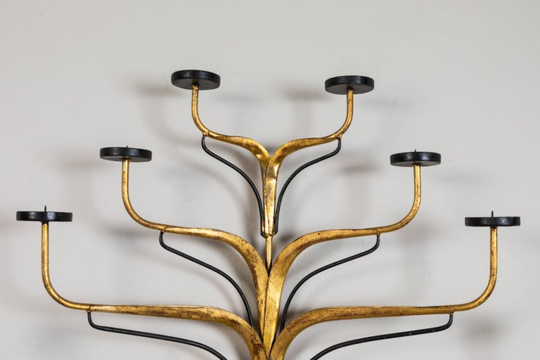 Hand-wrought Italian sconces. Gilt and black paint. This is a pair but priced, and can be sold, individually.  Offered at Pat McGann Gallery.