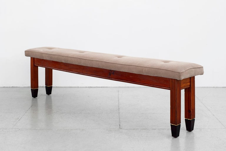 Incredible Italian oak bench - circa 1940s in the style of Paolo Buffa Long and slender with original neutral cushion Carved columned legs with brass inlayed detail and black tapered feet.