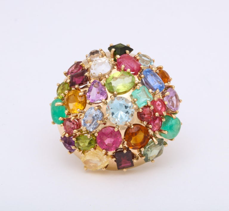 One 14kt High Polish Yellow Gold Ring Size 5.75 NOTE: MAY BE RESIZED. Embellished With Numerous Multi Colored Stones Composed Of Carved Rubies, Ceylon Sapphires,Citrines,Emeralds,Peridots,Yellow Sapphires,Amethyst,And Aquamarines. Dramatic Cocktail