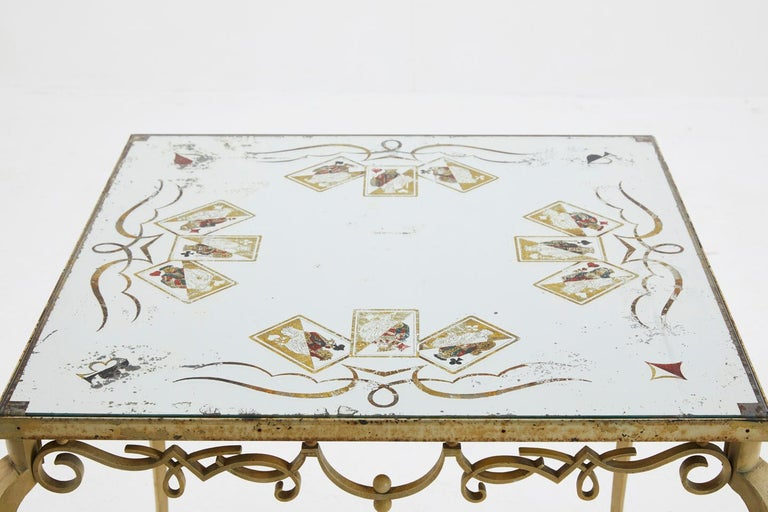 Beautiful 1940s églomisé mirror top table by Pierre Lardin, depicting jack, queen and king playing card images and fits on its original, painted and shapely steel base