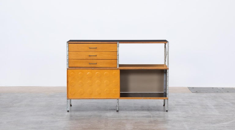 Plywood, laminate, metal, ESU shelf by Ray & Charles Eames, USA, 1949.  ESU shelf, multicolored by Charles and Ray Eames featuring an open area and three drawers in the upper section and two sliding doors in the lower section. The basic colour