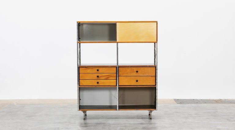 Charles and Ray Eames storage unit featuring five drawers in the middle area. Side and back panels feature a color combination of grey, beige and black. The shelf comes in good original condition with patina. Manufactured by Herman Miller.
