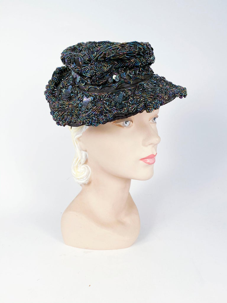 1940s Navy toy hat encased with navy iridescent beading and is to be worn perched on top of the head with the crown unstructured.