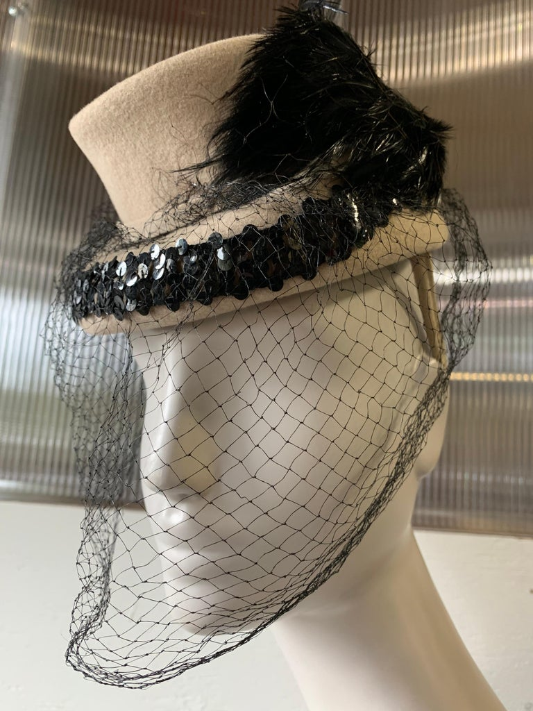1940s New York Creations Ecru Wool Tilt Top Hat W/ Feathers Sequins & Veil. One size fits all, with a strap to secure at back.