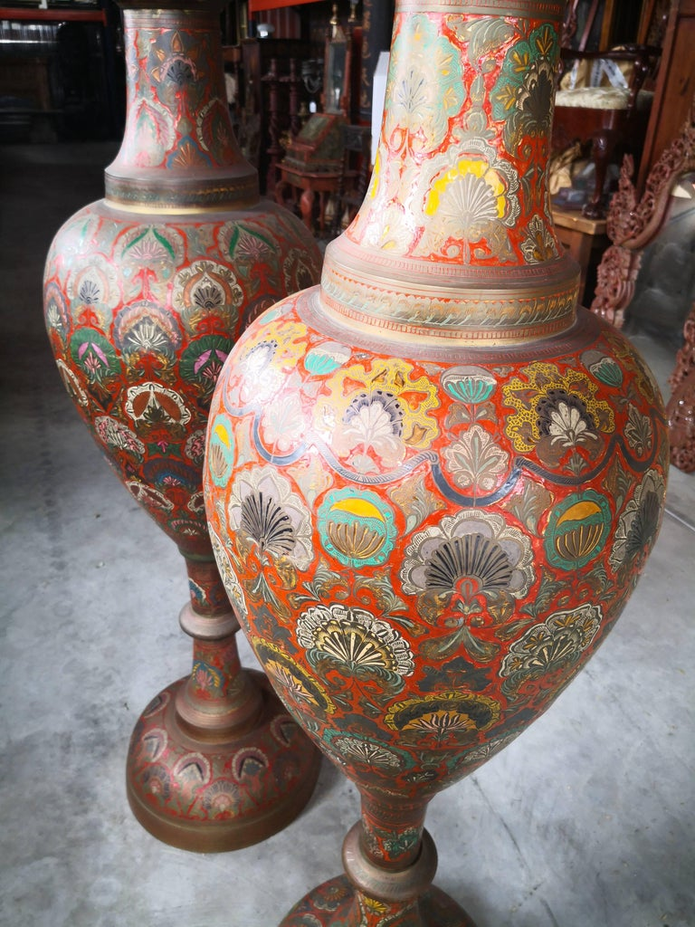 1940s pair of bronze polychrome enameled vases in Arabic style, using ornamental geometric and floral patterns.