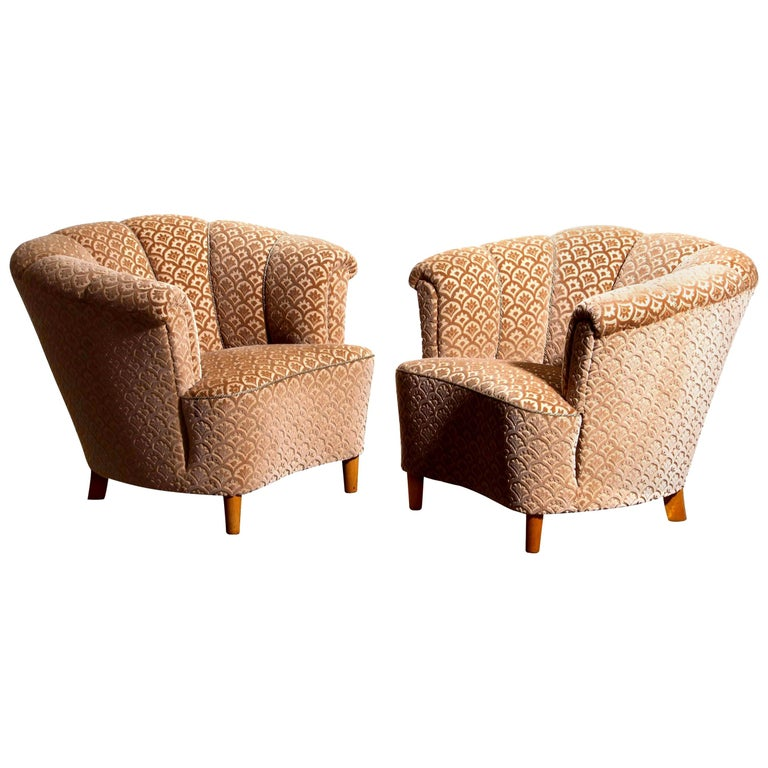 Beautiful set of two comfortable club lounge cocktail chairs from the 1940s.