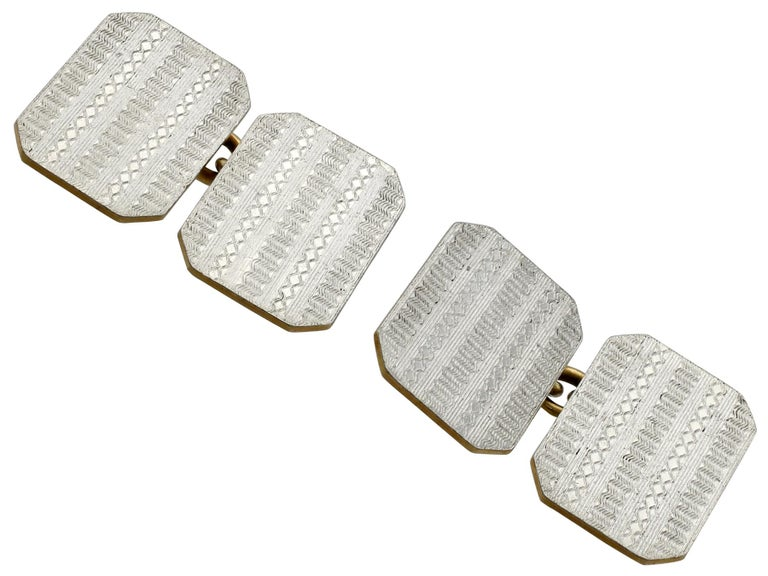 A fine pair of vintage English 18 karat yellow gold and platinum cufflinks; part of our diverse vintage jewelry and estate jewelry collections.  These vintage cufflinks have been crafted in 18k yellow gold and platinum.  The cufflinks have a