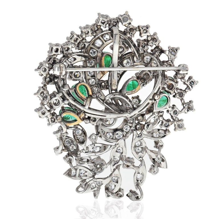 As you know, we love vintage brooches and we are always thrilled when we find one! Here is a platinum floral pin with green emeralds and diamonds. Diamonds are set upon the wires and are held by prongs. Five green emeralds of pear shapes are mounted
