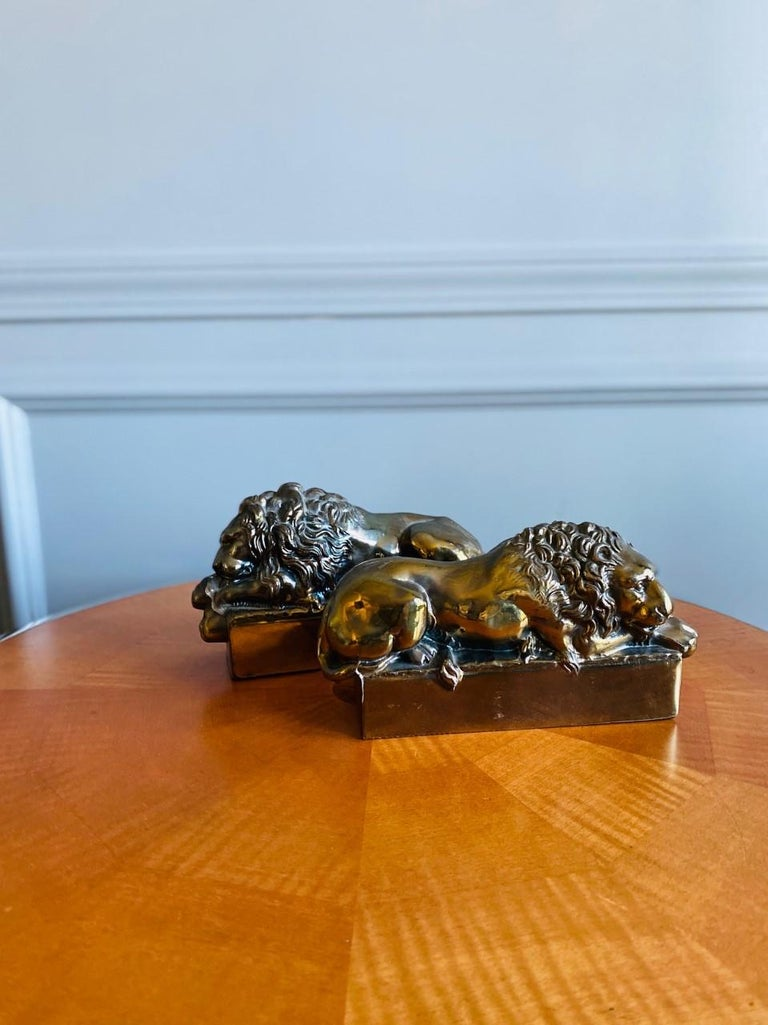 Hollywood Regency 1940s Polished Bronze Plated Antonio Canova Lion Bookends For Sale