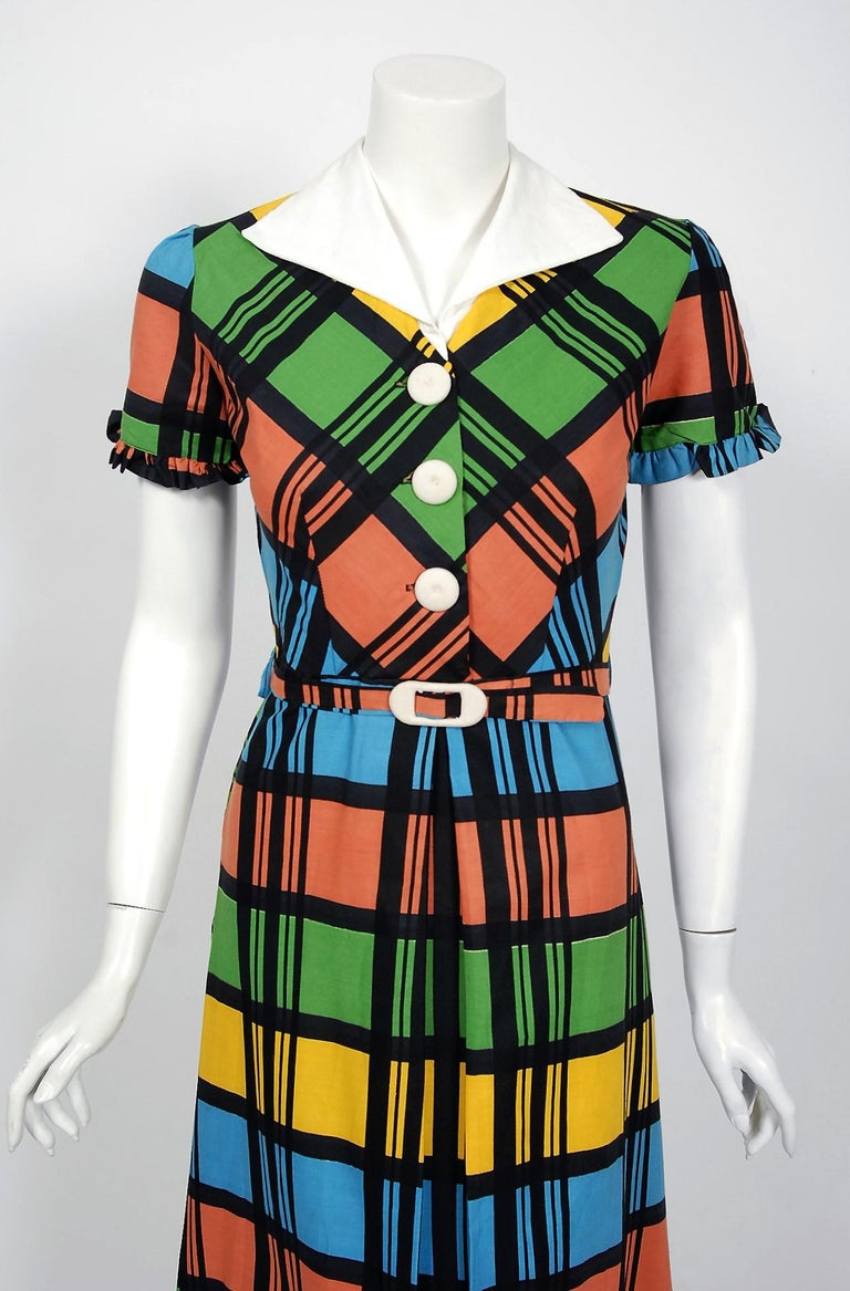 With its vibrant rainbow plaid print and flawless styling, this