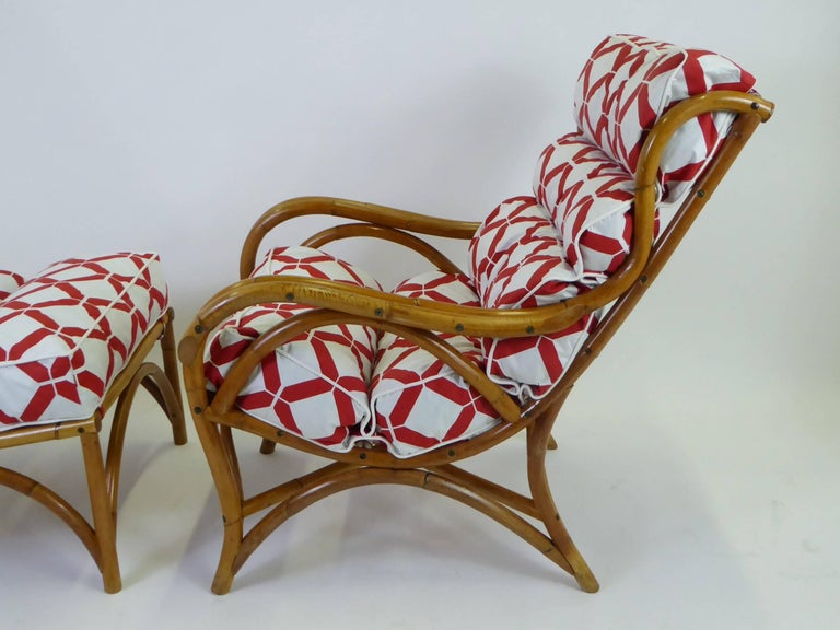 High style 1940s rattan lounge chair and ottoman with new lattice motif fabric cushion upholstery with ties. The two-piece ensemble of bent and shaped Rattan with a wing-back style upper. Comfortable leg supporting ottoman or footstool slopes