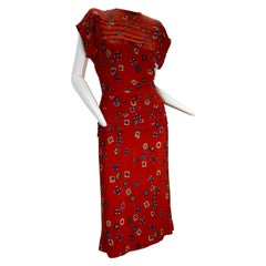 1940s Red Rayon Print Crepe Swing Dress With Pleated Peplum and Shoulders