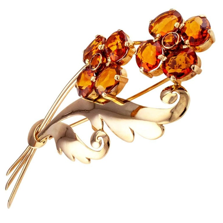 Retro 1940s citrine and gold flower brooch. Like many Retro brooches, this one is large in scale, but the simplicity of its design makes it a lovely thing to look at, to possess. Two flower stems and accompanying foliage, the flowers formed by