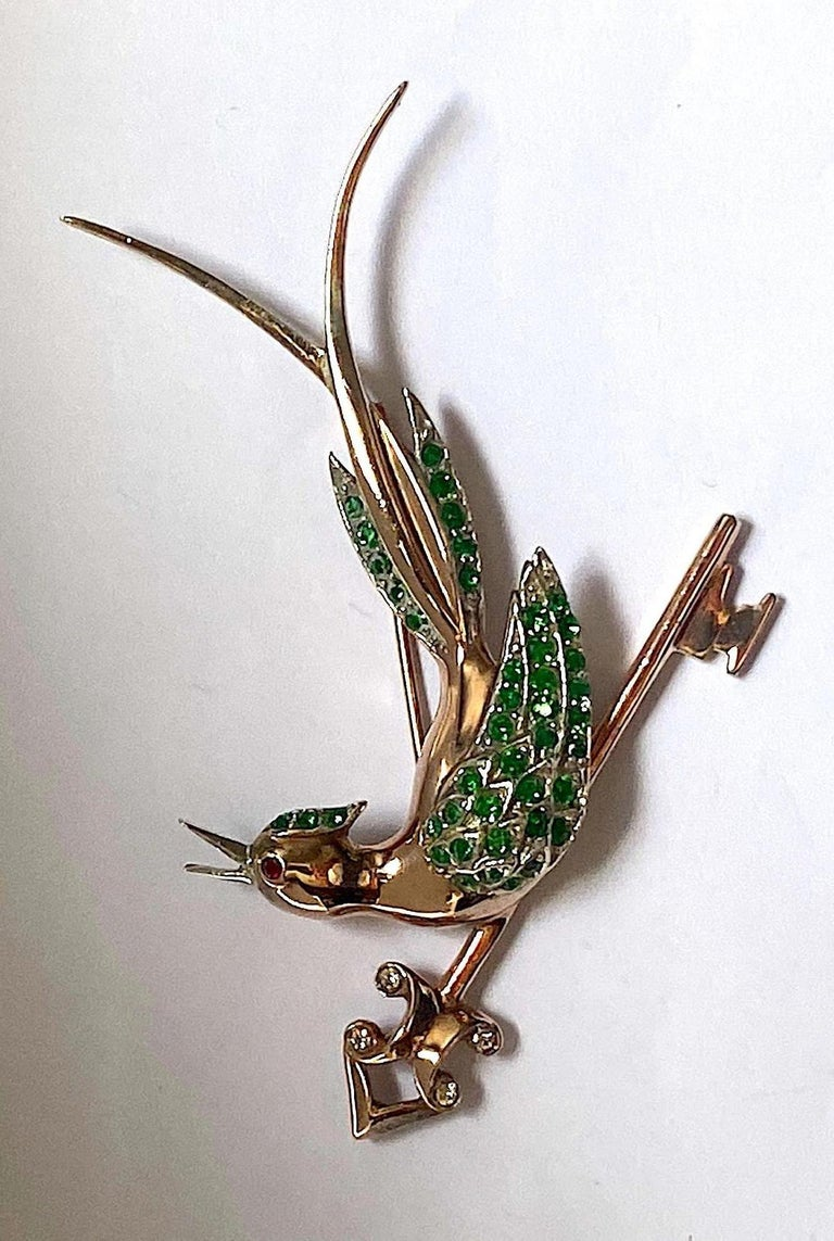 A charming and whimsical 1940s brooch of an animated bird singing
