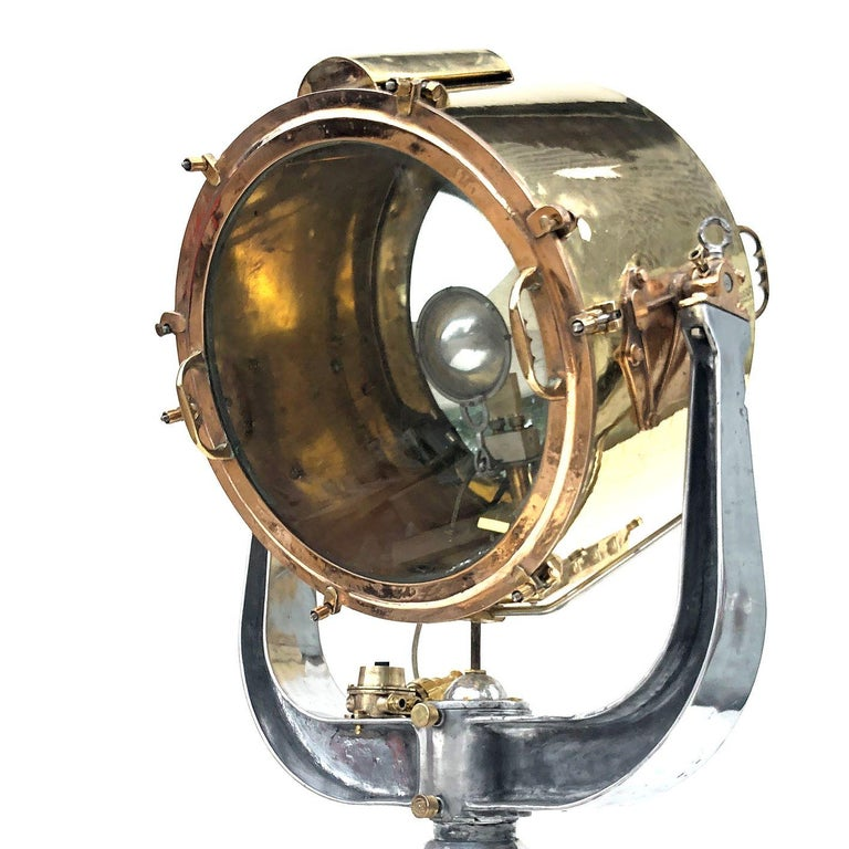 An extremely sought after naval searchlight dated circa 1940 and made by Rotherham's of Coventry, England. Professionally restored by Loomight in the UK ready for modern use.   Voltage - 110v or 220v compatible, we will send the correct bulb for
