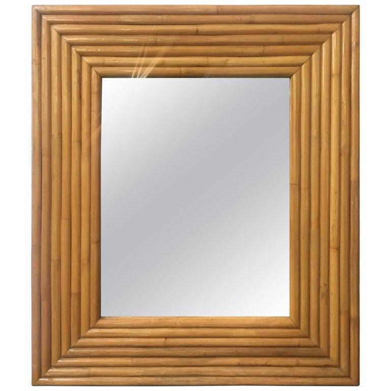Large square mirror featuring a seven-stand rattan frame, circa 1940.  Measures: Frame- H 44 in x W 38 in.  Mirror- H 28 in x W 22 in.   Restored to new for you.  All rattan, bamboo and wicker furniture has been painstakingly refurbished to the