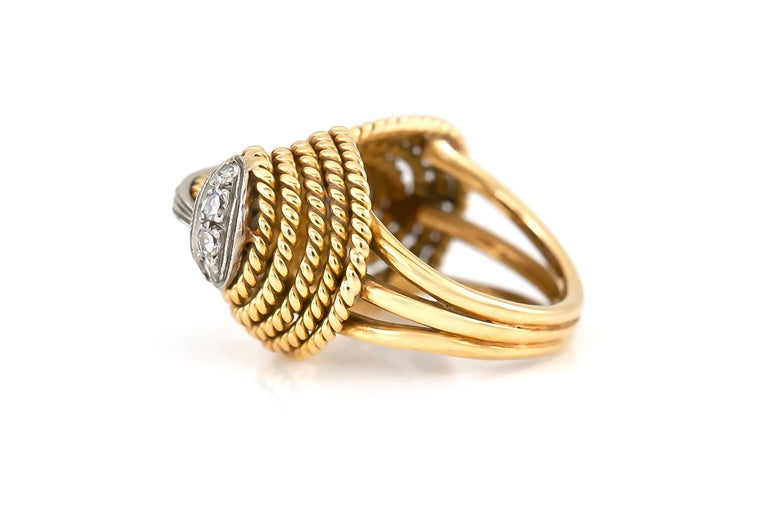 The ring is finely crafted in 18k yellow gold with diamonds weighing approximately total of 0.40 carat. Circa 1940.