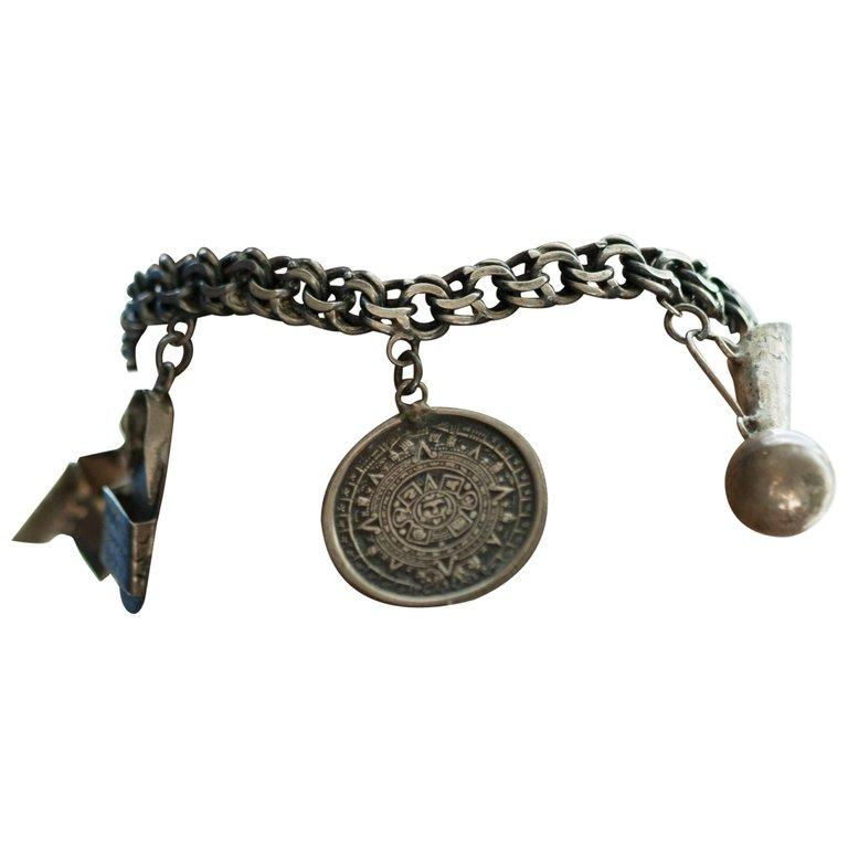 1940s Sterling Silver Mexican Charm Bracelet In Good Condition For Sale In Hicksville, NY