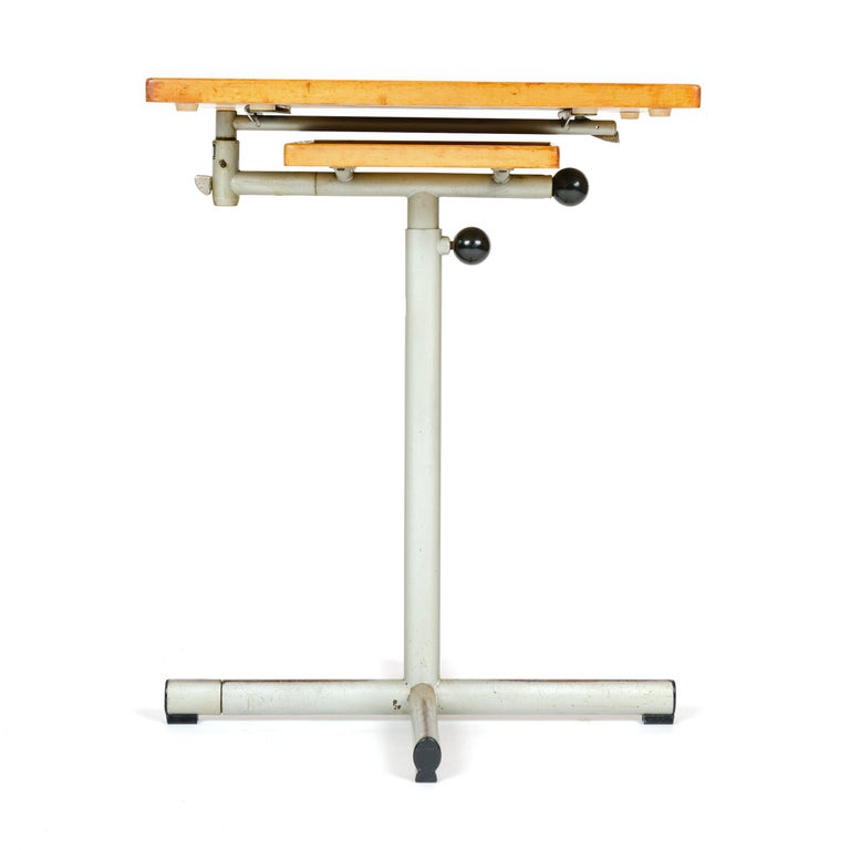A beautifully engineered utility tray table or workstation with a copper plated steel base and a bakelite handle. The upper surface swings around has a 90º tilt and adjusts to 26