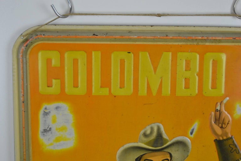 Belgian 1940s Tin Advertising Sign for Colombo Cigarettes with a Smoking Cowboy For Sale