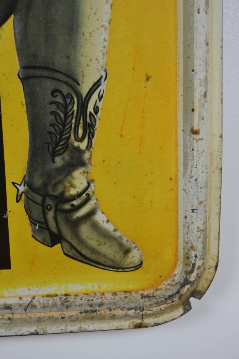 1940s Tin Advertising Sign for Colombo Cigarettes with a Smoking Cowboy In Good Condition For Sale In Antwerp, BE