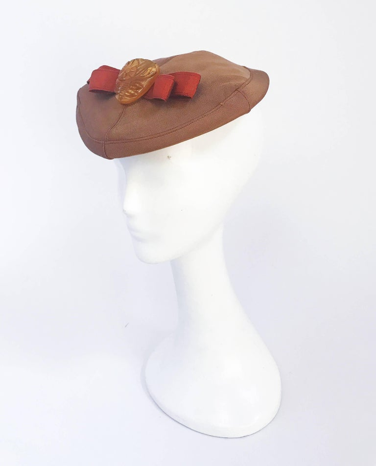 1940s Twill Gold-toned Hat with Rust-toned Gros-grain Ribbon and Bakelite Clip. Open-sized.