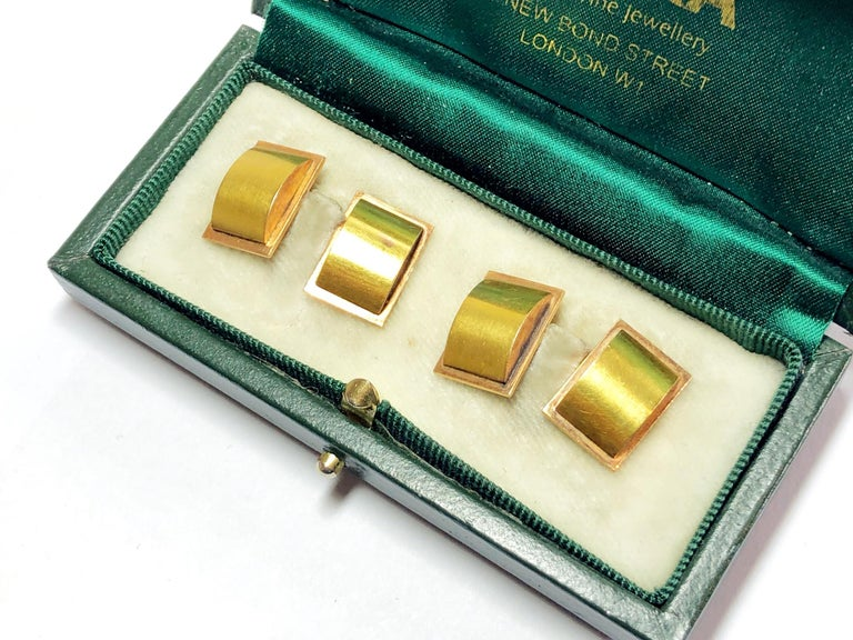 A pair of rectangular gold cufflinks, with red gold rectangular back plates and yellow gold domed curves, circa 1945