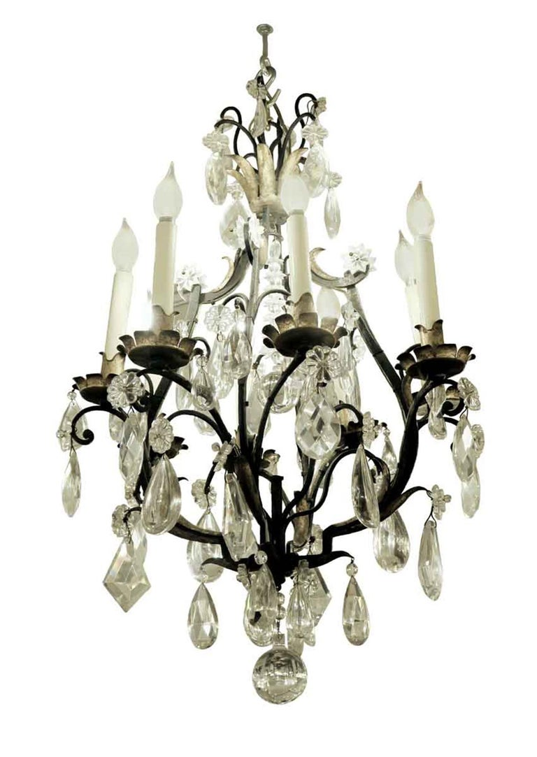 Venetian style iron six arm chandelier with gilded gold leafed metal details and heavy cut crystals from the 1940s. This can be seen at our 2420 Broadway location on the upper west side in Manhattan.