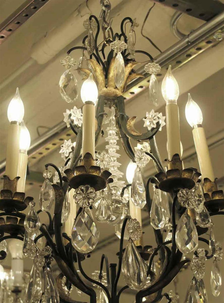 Mid-20th Century 1940s Venetian Iron 6 Light Chandelier with Heavy Cut Crystals and Gilded Leaves For Sale