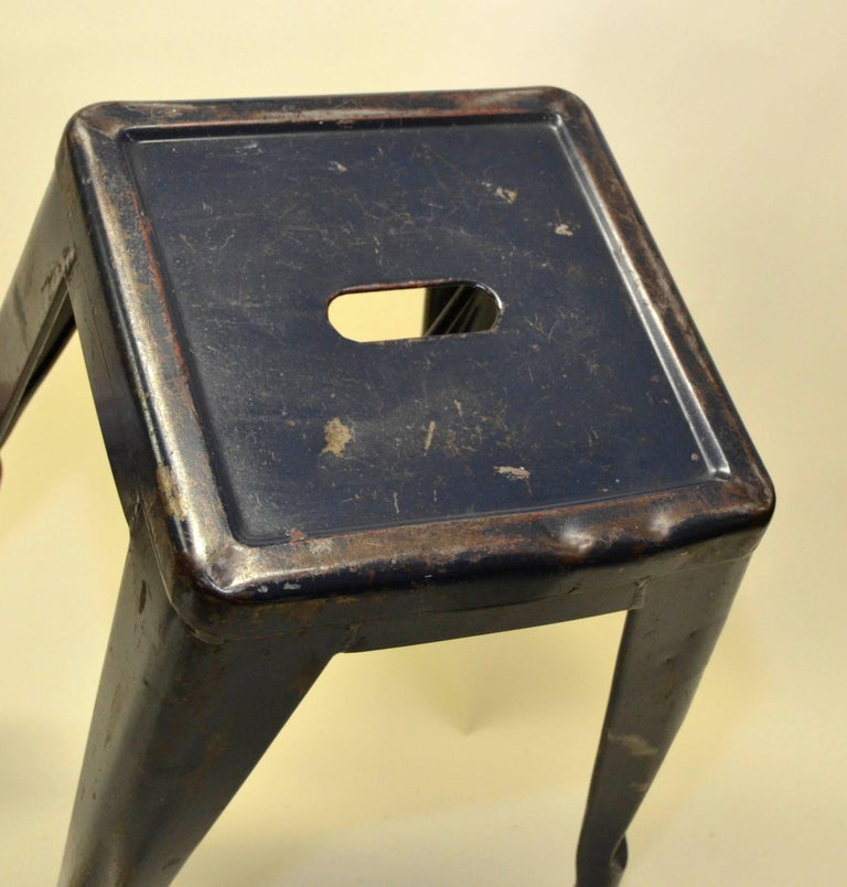 1940s Xavier Pauchard pair of industrial vintage model H24 blue navy enamel metal Tolix stools for the French Air Force.   French Air Force symbol at the bottom of the stools.  Collector's note:  This set of two model H45 vintage stools were