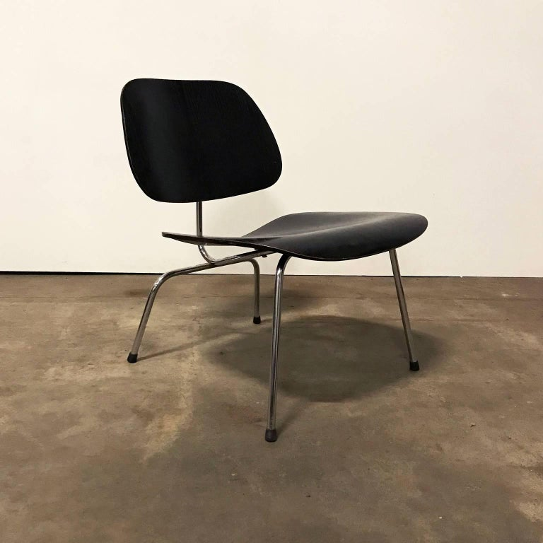 LCM with black wooden seat by Charles Eames, produced by Herman Miller. Very elegant design. The base is in good condition with just some spots. The backrest has some tiny damage and on the edge some loss of paint/lacquer (see picture #8). The seat
